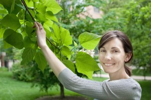 Sarah Somers stands next to engagement catalpa tree